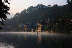 Sunrise with fog in china town stock images