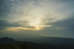 Sunrise, fog and clouds on the mountain landscape.  Royalty Free Stock Photo
