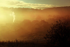 Sunrise with fog in countryside Royalty Free Stock Images