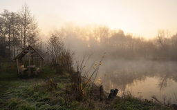 Sunrise through the fog. Sunrise in the forest on the lake, fog, the first frost Stock Photography