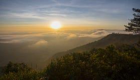 Sunrise on the fog mountain Royalty Free Stock Photography