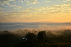 Sunrise and fog Mountain village Royalty Free Stock Photos