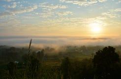 Sunrise and fog Mountain village Stock Images