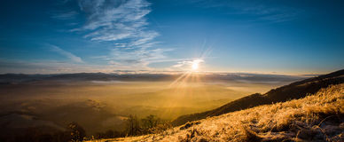 Sunrise in fog mountains Stock Photo