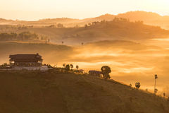 Sunrise, Fog and ray on the hill Stock Image