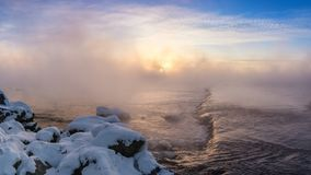 Sunrise on foggy lake in winter, Russia, Ural Royalty Free Stock Images