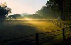Sunrise in foggy landscape Royalty Free Stock Images