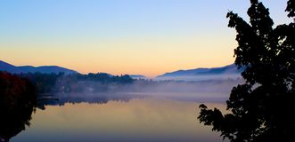Sunrise foggy Mirror Lake NY Royalty Free Stock Image