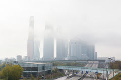 Sunrise in the foggy morning over Moscow city. Stock Image