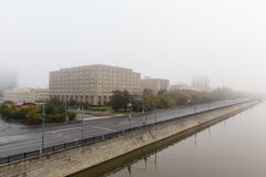 Sunrise in the foggy morning  over Moscow city. Stock Photography