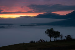 Sunrise in foggy mountains Royalty Free Stock Image