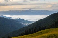 Sunrise foggy mountains Royalty Free Stock Image
