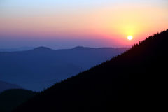 Sunrise in forest and mountainous areas. The sunrise in forest and mountainous areas Royalty Free Stock Image