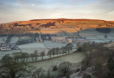 Sunrise on a frosty hillside Stock Photography