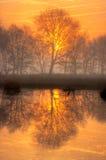 Sunrise on a frozen lake Stock Image