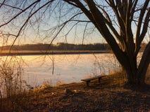 Sunrise at frozen lake Stock Photo