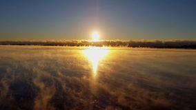 Sunrise on Frozen Lake stock video