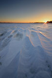 Sunrise on the frozen river Royalty Free Stock Photo