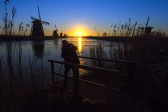 Sunrise on the frozen windmills alignment Stock Images