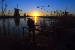 Sunrise on the frozen windmills alignment Stock Photo