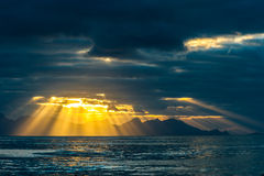 Sunrise through a gap in the clouds Royalty Free Stock Photo