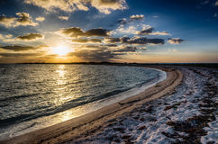 Sunrise on Garden Key. Sunrise on beach, illuminating hundreds of birds at feeding time, near Port Jefferson at Dry Tortugas National Park in the Florida Keys Stock Image