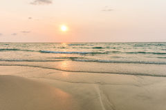Sunrise and gentle wave at the tropical beach Royalty Free Stock Photo