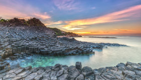 Sunrise on Giant Causeway. Phu Yen, Vietnam as the sun radiating aura prepared horizon to catch a beautiful new day stock photography