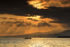Sunrise at gili meno with ray of light and mountain view Stock Images