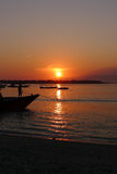 Sunrise at Gili Trawangan. The local people working to park their boat during beautiful sunrise Stock Image