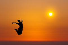 Sunrise (girls jump) Royalty Free Stock Photography