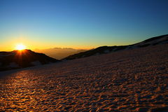 Sunrise and glacier. Big sunrise or sunset on the glacier in the alps. Superb mountain landscape Royalty Free Stock Photos