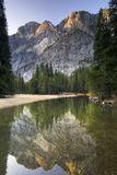 Sunrise on Glacier Point from the Merced river. Yosemite National Park, California, USA Royalty Free Stock Photo