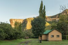 Sunrise at the Glen Reenen Rest Camp in Golden Gate. GOLDEN GATE HIGHLANDS NATIONAL PARK, SOUTH AFRICA - MARCH 14, 2018: The golden sandstone cliff of the royalty free stock photo