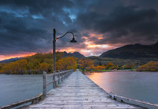 Sunrise at Glenorchy jetty, New Zealand. Smooth water on lake Wakatipu Royalty Free Stock Photography