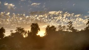 Sunrise with glow. Cloudy sunrise with glow effect Royalty Free Stock Image