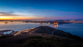 Sunrise at Golden Gate Bridge and city of San Francisco Stock Photo