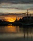 Sunrise, golden hour in Bristol. ENGLAND, BRISTOL - 13 SEP 2015: Sunrise, golden hour in Bristol, harbour Stock Images