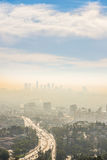 Sunrise golden hour view of Los Angeles downtown. Sunrise golden hour view of smog over Los Angeles downtown from Hollywood Hills Stock Image
