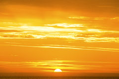 Sunrise on a golden ocean. The sun rises and the ocean glows with golden color Stock Image
