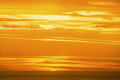 Sunrise on a golden ocean. The sun rises and the ocean glows with golden color Royalty Free Stock Photo