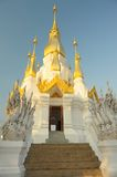 Sunrise the golden pagoda at the top in temple. Stock Photos