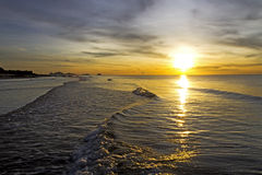 Sunrise golden on wave Royalty Free Stock Photography