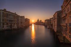 Sunrise on Grand Canal in Venice. Beautiful sunrise over the Grand Canal in Venice looking  towards the Basilica di Santa Maria della Salute Royalty Free Stock Photography