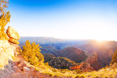Sunrise in Grand canyon with sun over other rim Royalty Free Stock Images