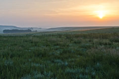 Sunrise and grassland Stock Photos