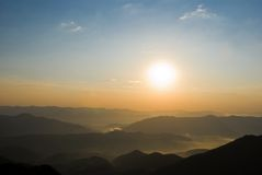 Sunrise in a green hills Royalty Free Stock Photo