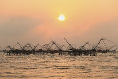 Sunrise with group of fish lift nets Stock Image