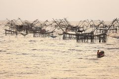 Sunrise with group of fish lift nets Royalty Free Stock Image