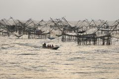 Sunrise with group of fish lift nets Stock Photos